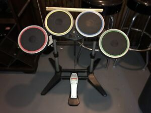 Wii rock band drums guitar and 2 games
