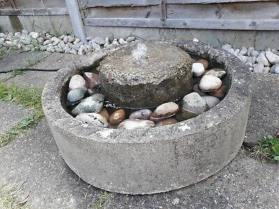 MILLSTONE WATER FEATURE FILLED WITH DECORATIVE PEBBLES FOR GARDEN OR PATIO