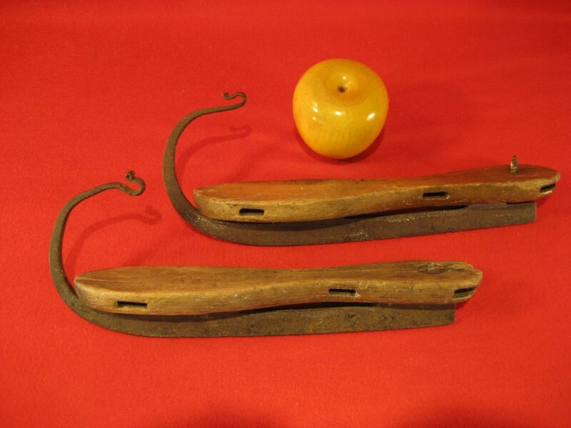 EARLY ANTIQUE HAND FORGED IRON AND WOOD ICE SKATES
