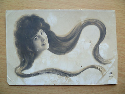Vintage Postcard- A LOVELY LADY WITH VERY LONG HAIR GIVING INNOCENT SMILING