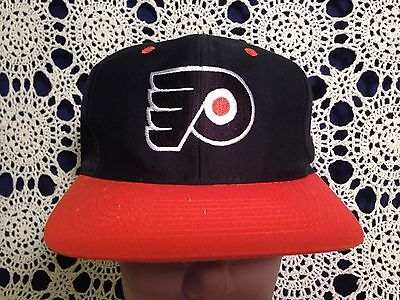 4c732ce4 Vintage Philadelphia Flyers Black and Orange Logo Athletic SnapBack Hat Cap