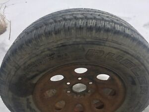 265/70/17 Bridgestone Dueler AT, on Chev rim ,$99.