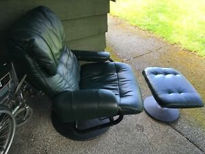 Dark green/almost black leather recliner chair and stool