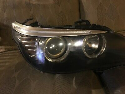 Halogen headlight 2008 BMW 528i passenger side includes bracket and bulbs - used