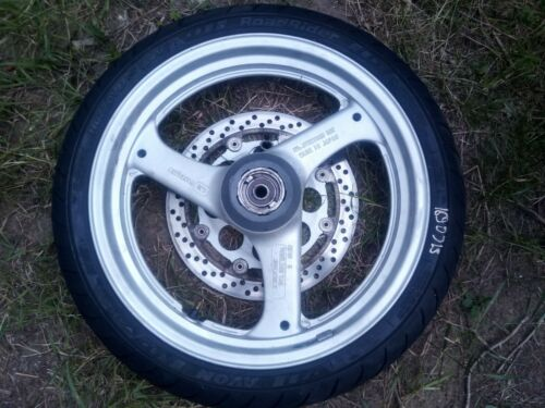Suzuki GS500 front wheel with tyre and brake rotor.Avon tire