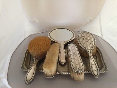 5 PIECE SOLID SILVER BACKED DRESSING TABLE SET ON A MATCHED SILVER PLATED TRAY