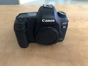 Canon 5D Mark II with battery grip, 2 batteries, and charger
