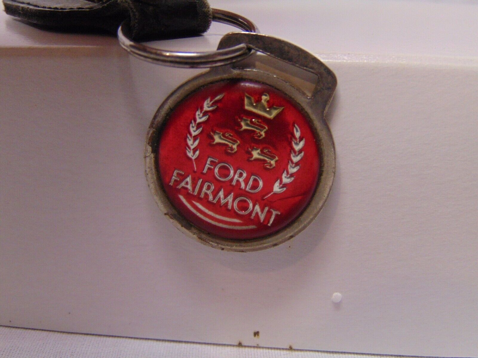 """vintage Ford Fairmont key chain fab 1 1/4"""" round red color w/ crown"""