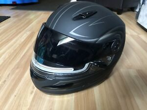 Women's snowmobile helmet, jacket and boots