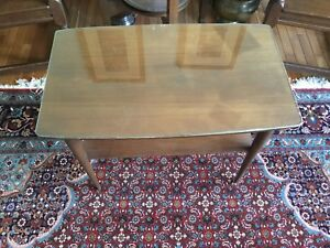 Mid century side table with glass top in walnut finish