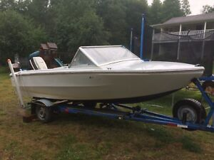 Boat motor and trailer for sale or trade