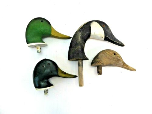 Four Wooden Decoy Heads
