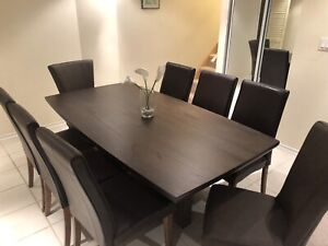 "42"" X 78"" dark brown dining table and 8 chairs"
