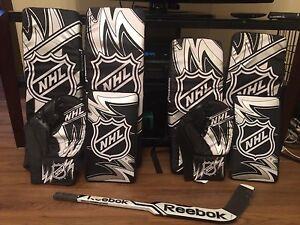 Mini hockey goalie pads (x2) and composite toy goalie stick