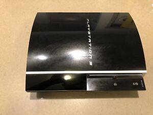 PlayStation 3 40GB with wireless controllers, games, and remote.