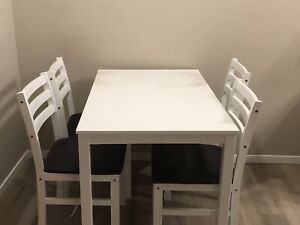 White wooden table and chairs
