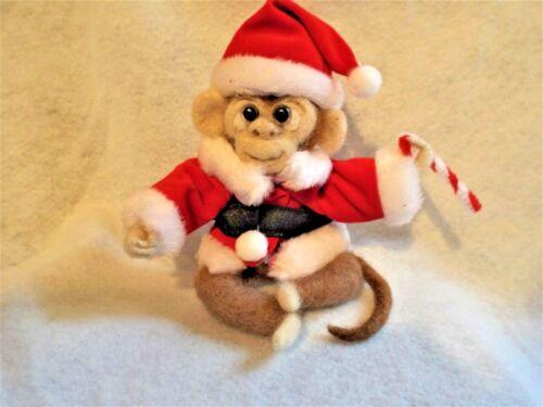 Needle Felted Monkey, Santa Suit and Candy Cane. .