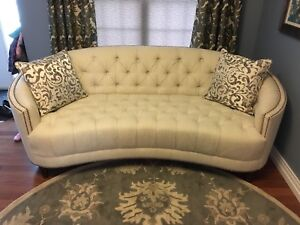 Tufted curved sofa