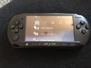 PSP E1002 + car charger + 4G memory stick Doonside Blacktown Area Preview