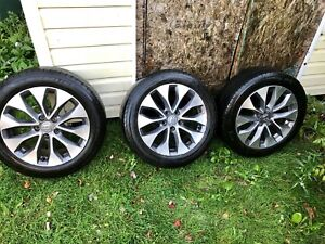 3 tires with rims, one brand new rim without tire $420 OBO