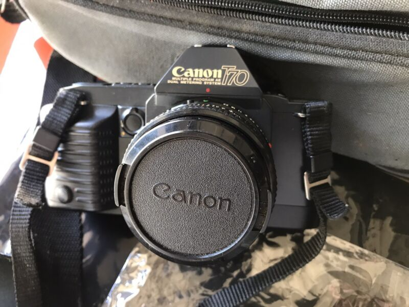Canon T70 35mm Camera, FD 50mm f/1.8 Len Flash dejur Light Meter