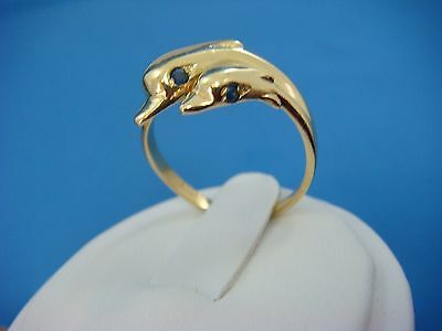 18K YELLOW GOLD 2 DOLPHINS WITH SAPPHIRE EYES LADIES RING 4 GRAMS, SIZE 8.5