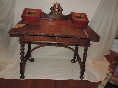 Spanish Revival  desk with leather top, twisted oak legs and wrought iron.