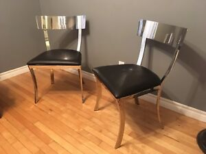 Beautiful pair of modern stainless steel and leather chairs