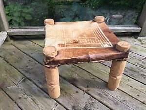 Vintage cow hide tribal wooden stool