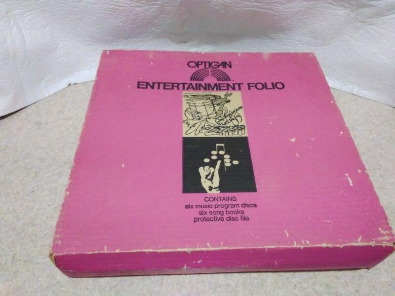 16 Optigan Discs in FOLIO CASE NO SONG OR MUSIC BOOKS.