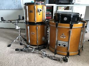 Pearl:  4 piece all maple shells with stands