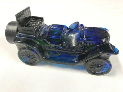 Vintage Avon Blue Glass Car Decanter with Partial Contents