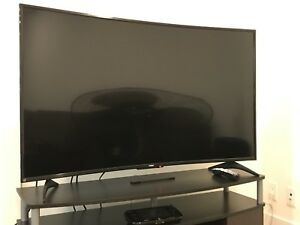 Reduced!!!  55 inch curved Haier tv and stand for sale