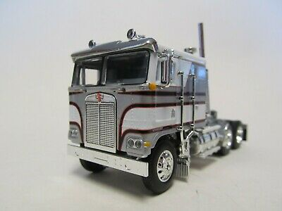 DCP / FIRST GEAR 1/64 SCALE KENWORTH K-100 FLAT TOP, WHITE & SILVER BLACK STRIPE