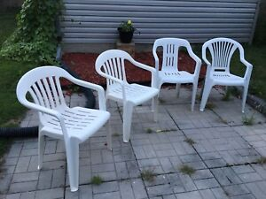 4 White Plastic Chairs - $10 for all of them