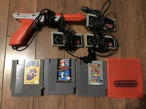NES Controllers & Games