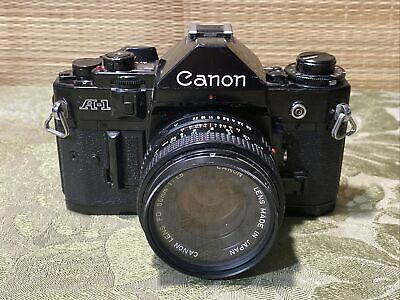Canon A-1 Film Black Camera With 50mm 1.8 Lens and Filter