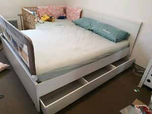 Ikea Queen size frame with four storage drawers
