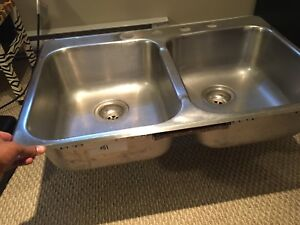 Kitchen sink with faucet and sprayer