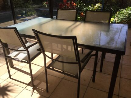Glass top outdoor dining table