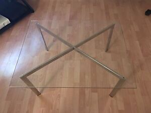 Glass table with silver cross legs