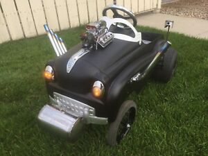 Custom pull and pedal cars