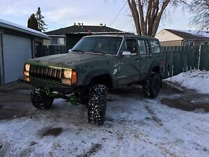 "1990 jeep Cherokee lifted 7"" w/5 speed"