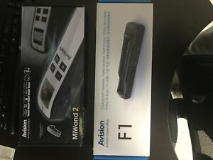 MiWand2 portable scanner with docking unit.