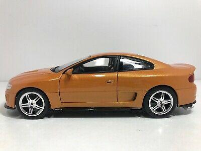 WELLY 2005 PONTIAC GTO RAM AIR 6 BURNT ORANGE 1:24 SCALE DIE CAST FREE SHIP
