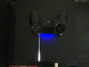PS4 500GB WITH 3 GAMES AND CONTROLLER