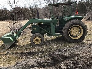 John Deere 519 with loader.