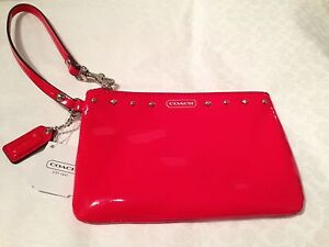 COACH Small Wristlet. New with tag. Comes in a coach gift box.