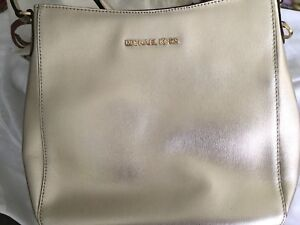 Micheal kors gold purse never used