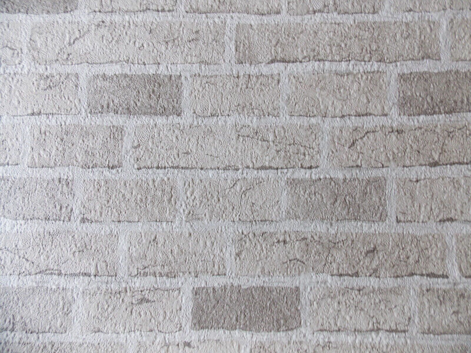 Textured Embossed Off White Grey Brick Wall Effect Feature Wallpaper 779830